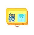 shoes and shirt on luggage vector image vector image