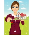 female real estate agent holding the key vector image vector image
