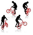 Set silhouette of a cyclist male performing