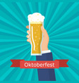 hand holding beer glass vector image