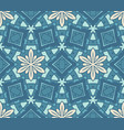 seamless pattern blue tiles with abstract flower vector image