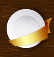 dish with gold ribbon vector image vector image