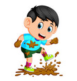 little boy running in the mud vector image