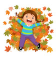 cute girl playing with falling leaves vector image vector image