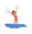 young woman in red swimsuit standing in blue water vector image
