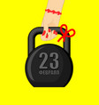 23 february kettlebell womans hand gives gift for vector image