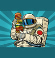astronaut with a giant burger vector image vector image
