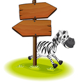 A zebra at the back of a wooden arrow board vector image vector image