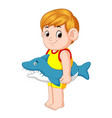 boy playing with shark inflatable ring vector image