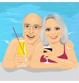 lovely senior couple drinking red wine in pool vector image vector image