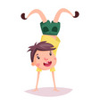 child or kid cartoon schoolboy doing handstand vector image