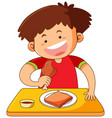 boy eating chicken on table vector image vector image