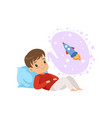 cute boy lying on a pillow and dreaming about vector image vector image
