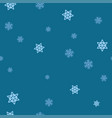 light blue snowflakes on a blue background vector image vector image