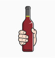 hand hold wine bottle male hand holding a wine vector image vector image