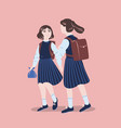 pair of girls dressed in school uniform walking vector image vector image
