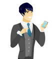 young asian groom holding a mobile phone vector image vector image