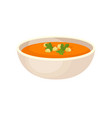 pumpkin cream soup with cream in a bowl vector image