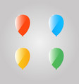 Colored shiny balloons on a gray background