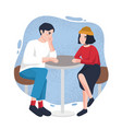 cute young man and woman sitting at cafe table vector image vector image