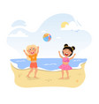 two happy little girls are playing with ball vector image vector image