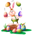 A bunny juggling the easter eggs vector | Price: 1 Credit (USD $1)