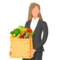 woman with paper bag full fresh vegetables vector image vector image