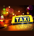 yellow taxi sign on the car against the lights of vector image vector image