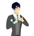 young asian groom showing golden ring on finger vector image vector image