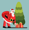 santa puts presents under the tree vector image vector image