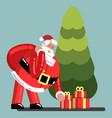 santa puts presents under tree vector image vector image
