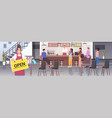 waiters taking off face mask holding open sign vector image vector image