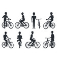 black silhouettes of bicyclist riding on bike vector image vector image