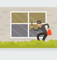 male burglar or robber in black mask breaking into vector image vector image
