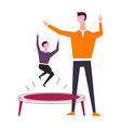 father and little son on round trampoline have fun vector image vector image