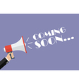 Hand holding megaphone with word Coming soon vector image