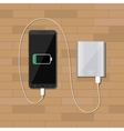 powerbank charging smartphone on wooden desk vector image