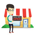 asian shop owner holding open signboard vector image vector image
