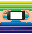 Hands Holding Phone And Colorful Background vector image