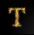 gold glittering letter t on black background
