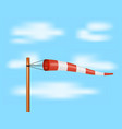 windsock in red and white design on blue sky vector image vector image