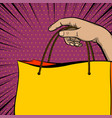 pop art sale banner hand hold shopper bag vector image vector image