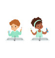 cute little boy and girl brushing teeth set daily vector image vector image