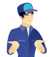 young asian confused mechanic shrugging shoulders vector image vector image