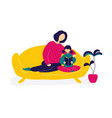 mother reading books with daughter on sofa vector image vector image