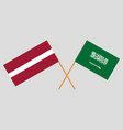 the ksa and latvian flags vector image vector image