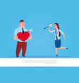 woman throwing arrows in man holding heart shape vector image vector image