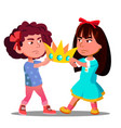 two little girls pulling out the crown from hands vector image