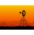 silhouette of a water pumping windmill at the vector image vector image