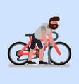 man pumps the wheel of his bike vector image
